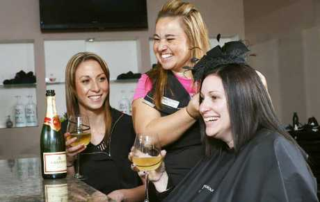 Giggles Hair Studio is holding a Champagne breakfast before the Ipswich Cup. Pictured are owner Kristy Midgley (centre), manger Katie Upton (left), and customer Jodie Caruana. 