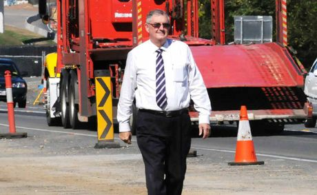 Gympie mayor Ron Dyne walks the Bruce Hwy near one of three new bridges.