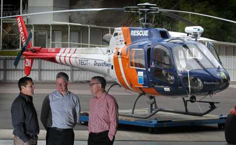 Pilot Liam Brettkelly, chairman of TECT Michael Cooney, and community relations manager for TrustPower, Graeme Purches.
