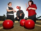 Tugun Bendigo Bank's Shylah Kenny (left) and Wendy Anderson(right) get excited about the upcoming charity bowls event with Tuguns Bowls Club President Gary Moronry Photo- Blainey Woodham / Daily News