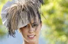 Fashions on the Field women's winner Amy Robson complemented dress with a fur shawl at the Ipswich Cup.