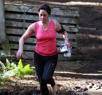 HARD YAKKA: Rissington's Cheri Gallagher runs while holding her shoes during the short course event of the Plus Rehab Pickled Pukeko, the second event of the Inov-8 Hawke's Bay Trail Run series, near Waipukurau yesterday.PHOTO/GLENN TAYLOR HBT122665-15.JPG