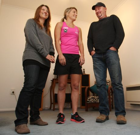 Black Sticks player Gemma Flynn with her parents Michelle and Rob.