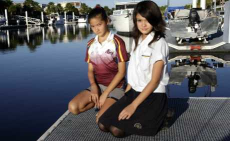 Alesha and Emily Sands are concerned about the rubbish and sewerage in the Bribie canals. Photo Vicki Wood / Caboolture News