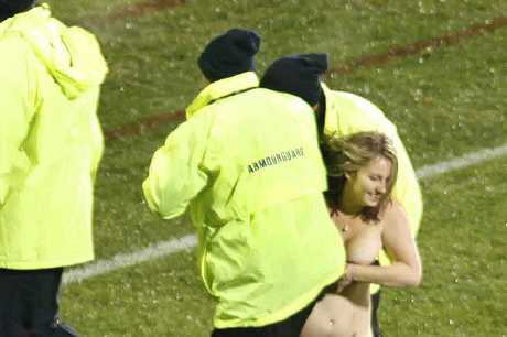 Caught in action: Last Saturday's streaker being apprehended by security staff