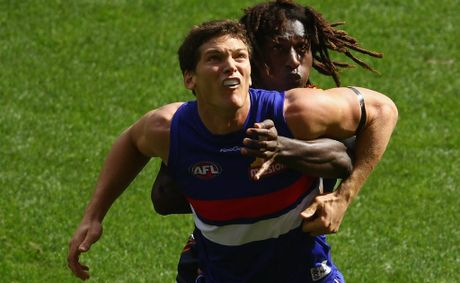 "Tony Liberatore believes the sledge Will Minson (front) directed at Port Adelaide's Danyle Pearce regarding his mother was ""totally unacceptable""."