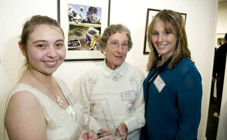 Bruce MacKenzie Memorial Youth Award recipient Amy Knie (left) with Norma and Lauren MacKenzie at the 24th Heritage Acquisitive Photographic Awards 2012 at USQ.