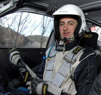 David Holder straps in for a ride with Production WRC champion and mentor Hayden Paddon.