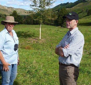 Taumarunui farm owner Glenda Wade (left) discusses how tree planting programmes reduce  erosion and hill country run-off with Federated Farmers national president Bruce Wills.