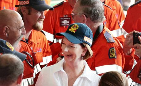 Julia Gillard meeting with SES volunteers in Ipswich on the anniversary of the Brisbane floods.