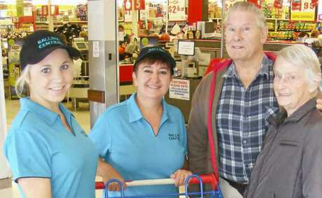SHOPPING HELP: Pictured are Ballina Central's helpers Kaitlin Slack and Toni Caesar with Ballina couple Alan and Dorothy Bremner.