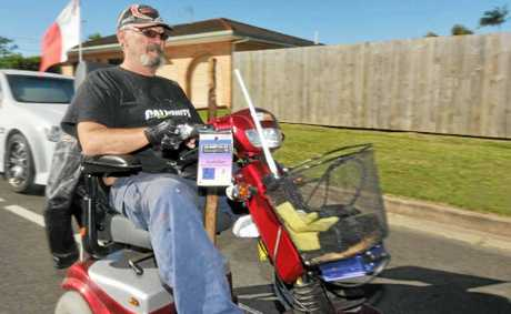Graham relies on his mobility scooter to get around but says sometimes he has to travel along busy roads due to a lack of footpaths or crossings.
