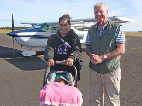 THERE AND BACK: Six-week-old Magic Hoani, his mum Shannon and Angel Flight pilot Alistair Leggat, safely on the ground again at Kaitaia Airport.