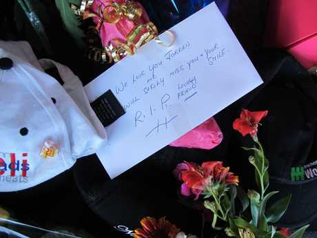 Tribute left outside Jordan Vourdouris' restaurant Mykonos Pizza and Pasta in Paeroa.