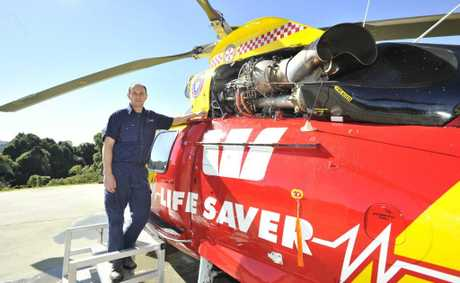 Heath McDonald, chief engineer for the Westpac Life Saver Rescue Helicopter, doing a scheduled inspection for the primary aircraft in Lismore.