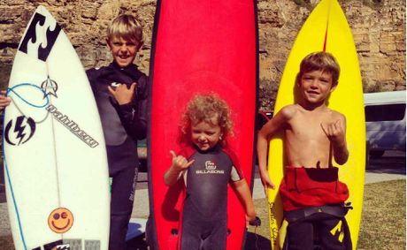 Yamba kids Dakoda Walters (10), Evie Walters (3), and Harley Walters (6) have inherited a keen interest in surfing from their dad, Jeremy Walters.