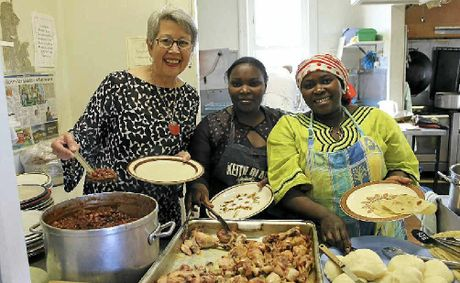 Mayor Jenny Dowell, Kitumaini Bisoka and Djidji Sanvura dish up an African lunch at the Winsome soup kitchen.