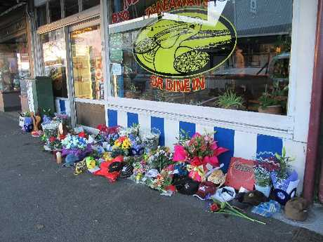 Tributes to dead businessman Jordan Voudouris placed outside Mykonos Pizza and Pasta at Paeroa.