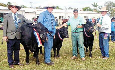 WINNERS: Handlers from Yeppoon High School and Timitch Hill and Norm Erikson with the supreme champion cattle of the Yeppoon Show.