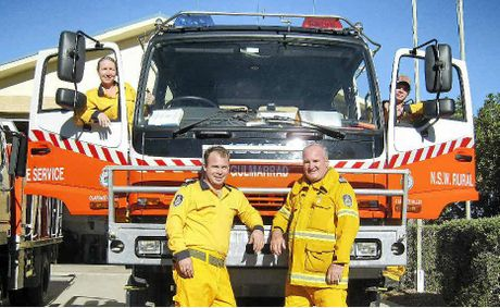 Gulmarrad RFS members Tania Peene, Johnno Carr, Mark Carr (captain) and Shawn Peene are helping out the Anglican Op Shop.