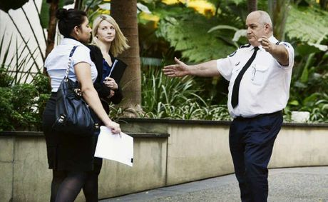 A security officer directs people away after a bomb threat interrupted the Gerard Baden-Clay court case.
