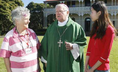 Archbishop Mark Coleridge with students Elizabeth McKenna (left) and Mengji Han at Woodlands of Marburg.