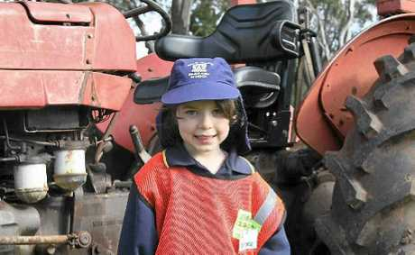 FARM SAVVY: Impressed by a big red tractor at the Downlands ag plot is Grace French.
