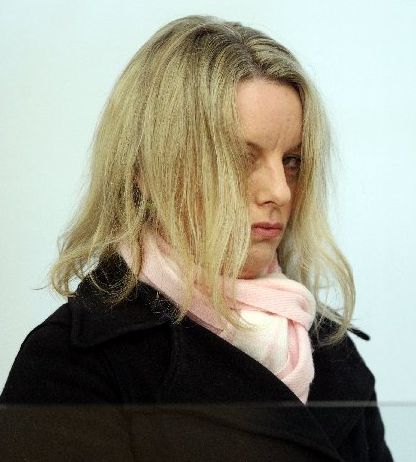 LAWYER IN THE DOCK: Sacha Beacham yesterday failed to prevent her photograph being taken in court when convicted for resisting and obstructing police on New Year&#39;s Eve. 