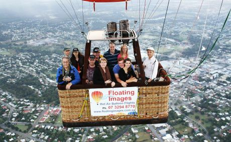 Floating Image passengers with Chief Pilot and Owner Graeme Day (right) over Ipswich City.