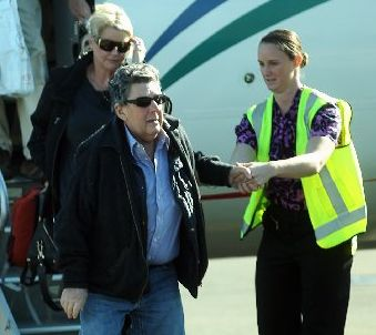 SETBACK: Paul Holmes was yesterday in Hawke's Bay Hospital after arriving back from Auckland last week, where he underwent open-heart surgery. He is pictured arriving in Hawke's Bay with his wife Deborah (left).