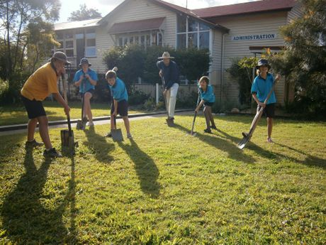 Conondale State School principal Mark Winrow and students Ethan Mundt, Sarah Kennedy, Daniel Gilliland, Chloe Lanham and Lauren Purcell go searching for missing time capsules in the school grounds. Photo: Contributed