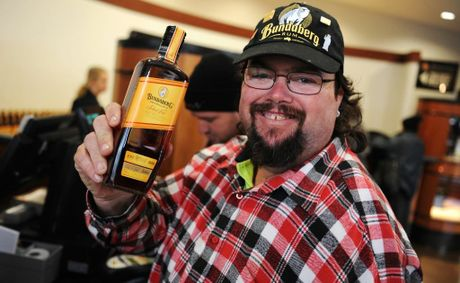 Jason Tomkins waited 11 days to ensure he got the first bottle at the launch of the new Bundaberg Original Select Vat at the bond store.