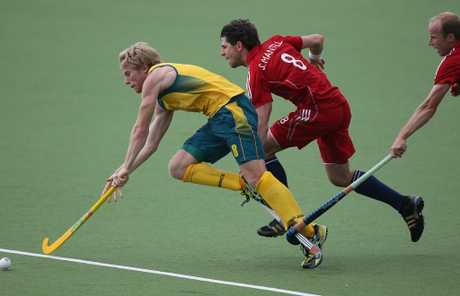 Matthew Butturini in action for Australia against Great Britain. His marvellous defensive skills ensured he would be selected to represent Australia at the London Olympic Games.