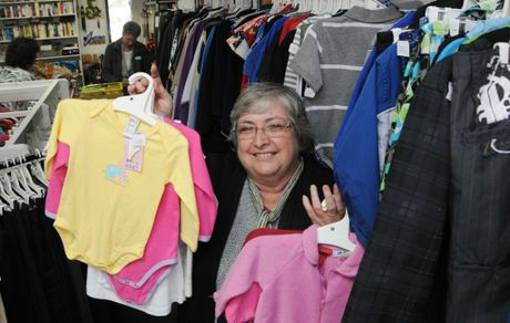 Lifeline volunteer Margaret Cook getting ready for the $2 sale.
