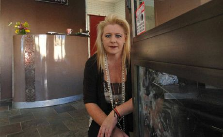 Donna Edye contemplates the cost of securing her hair salon after a vandal attack on Friday night.