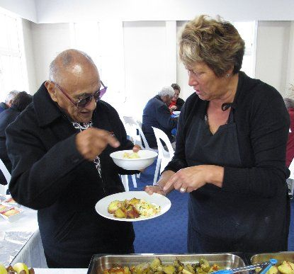 CHAT: Well-known kaumatua Te Wati Erueti compares notes on the meal with marae volunteer Becky Wihongi.