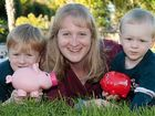 Lara Hodgson teaches her sons about saving money.