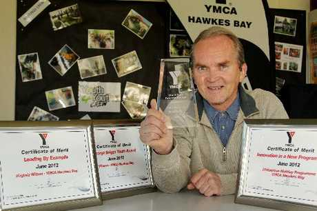 VOLUNTEER POWER: YMCA Hawke's Bay chief executive Peter Andersson shows the four national awards he and his team scooped at the organisation's national conference recently. PHOTO/WARREN BUCKLAND CLA120846-01