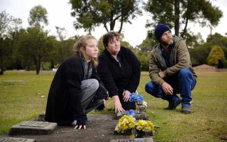Madeline, Katrina and Grant Tomlinson were devastated to find their brother and son's gravesite a mess.