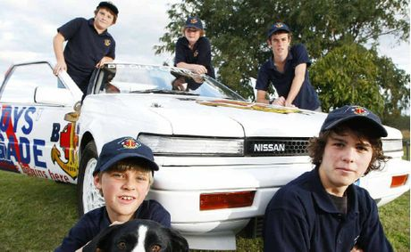 Taking part in Ipswich Boys' Brigade Strive 2 Drive project is (front from left) Josh Johanson, 8, Alice the dog, Matt Lynch, 14, (back) Jared May, 12, Kealy Gare, 12, and Kyle Williams, 17.