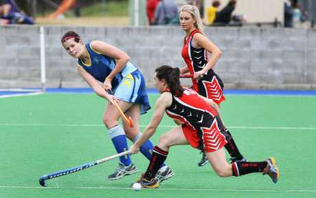 Hancocks A-grade player Sara Rogers (left) watches the ball closely during Saturdays 1-1 draw with Toowoomba Past High at the Ipswich Hockey Complex. 
