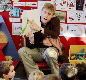 A staffer from Napier Library reads to children at Celebration of Matariki, Edukids, Riverbend Road, Napier.