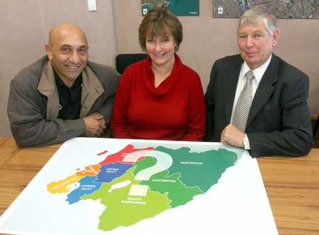SOMETHING'S GOTTA CHANGE: The three mayors with a map showing the territorial authority boundaries, left, Ron Mark (Carterton), Adrienne Staples (South Wairarapa) and Garry Daniell (Masterton).