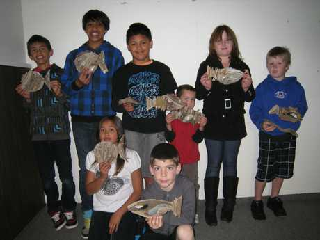 JUNIOR Acero, Jareer Acero, D'angelo Acero, Joseph Acero, Jack Cook, Mason Gooch, Hannah Bloor and Maz Wisnewski make driftwood fish at Stratford District Council's holiday programme at the library last school holidays. The programme has been cancelled.