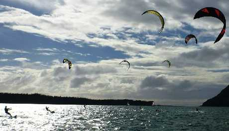 SKIMMING ALONG: Kiteboarders take to Tauranga harbour in the second of the Tauranga Yacht and Power Boat Club's winter kite series