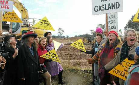 IN VOICE: The choir from CSG  The Musical sings it up at the Metgasco waste water holding pond near Casino.