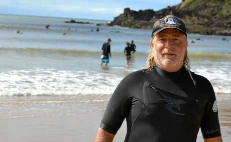 SUNNY SMILE: The rain cleared and Wayne 'Grom' Mellick had 30 in his surf lesson at Agnes Water beach yesterday.