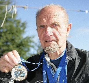 SWIM STAR: Fritz Bohme proudly displays the medals he won at the World Masters Games.