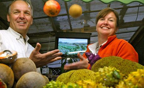 Malcom Harm and Kelly Patterson at Tropical Fruit World, which features river cruises, exotic fruit taste-testing and mini steam trains.