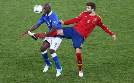 Mario Balotelli (L) of Italy and Gerard Pique of Spain battle for the ball during the UEFA EURO 2012 final match between Spain and Italy at the Olympic Stadium on July 1 in Kiev, Ukraine. 